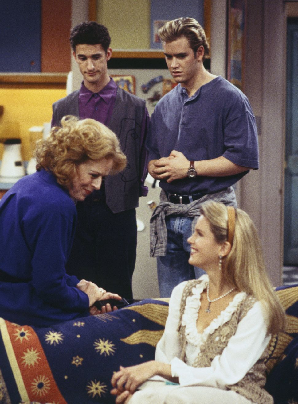 "Holland Taylor, Dustin Diamond, Mark-Paul Gosselaar and Anne Tremko in an episode of ""Saved by the Bell: The College Years."""