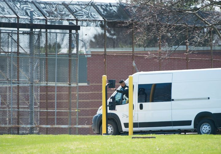 A transportation van arrives at the Ontario Correctional Institute in Brampton, Ont. on April 20, 2020. An outbreak of COVID-