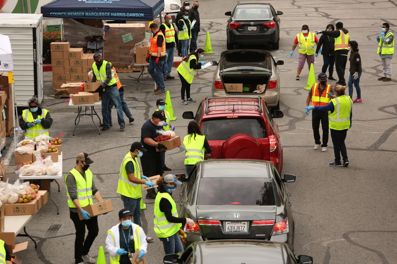 Cars line up at a shopping center in Los Angeles for food distribution for more than 2,500 families affected by the COVID-19 crisis.