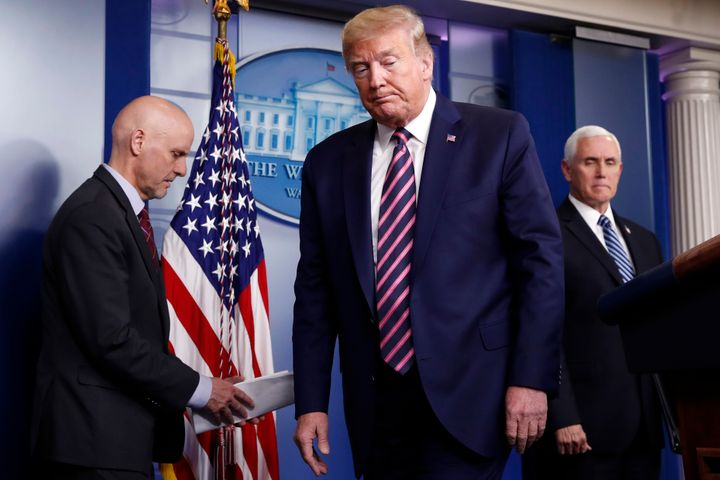 Trump steps away from the podium at the coronavirus briefing on Friday.