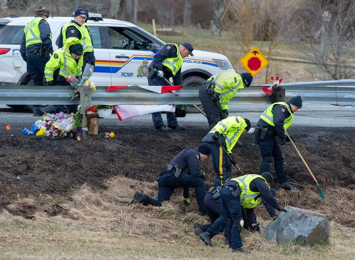 RCMP investigators search for evidence at the location where Const. Heidi Stevenson was killed along the highway in Shubenacadie, N.S. on Thursday.