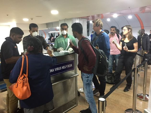 Travellers submit declarations at Trivandrum International Airport in Thiruvananthapuram (Trivandrum),...