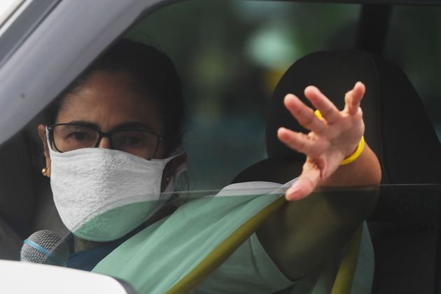 Chief minister of West Bengal Mamata Banerjee waves as she delivers a speech from her car in Kolkata...