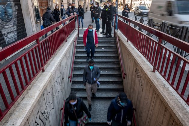 People walk to the San Giovanni metro station in Rome on April 24 during a three-hour testing period of new measures designed to reduce congestion on public transportation, April 24.