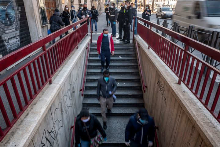 People walk to the San Giovanni metro station in Rome on April 24 during a three-hour testing period of new measures designed