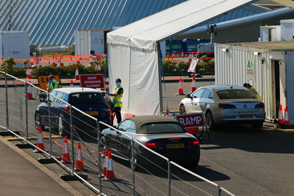 A drive-in coronavirus testing centre at Brighton & Hove Albion's American Express Community Stadium...