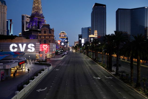 The Las Vegas Strip is devoid of the usual crowds and traffic after casinos and other business were shuttered...