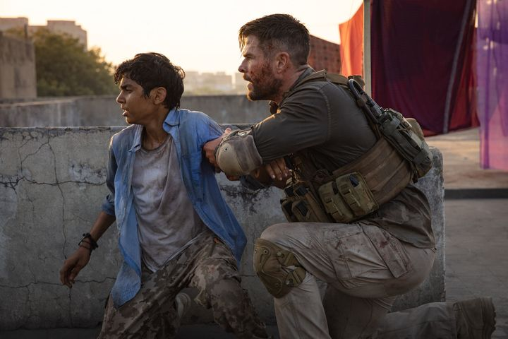 "Rudhraksh Jaiswal and Chris Hemsworth act in ""Extraction."""