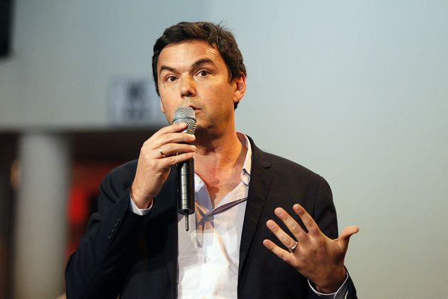 French economist Thomas Piketty delivers a speech as he takes part to a meeting of the Left Parties and...