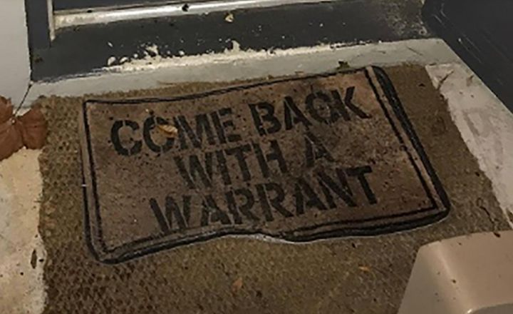 "A welcome mat at the front door of a Florida home read ""come back with a warrant"" — and that's just what deputies did before"