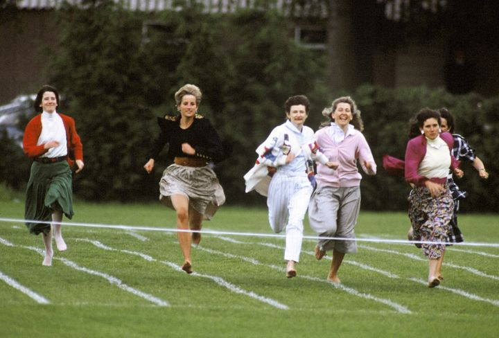 "Princess Diana runs in a ""mothers race"" during Wetherby School's sports day in 1991."