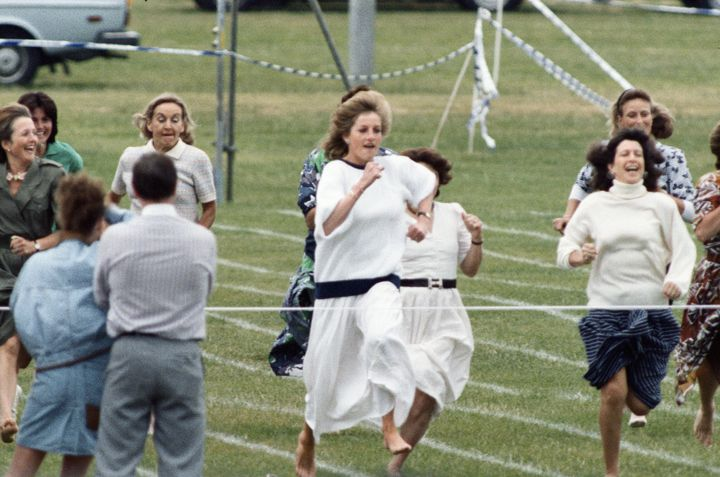 Princess Diana competes in the sports day race in June 1989.