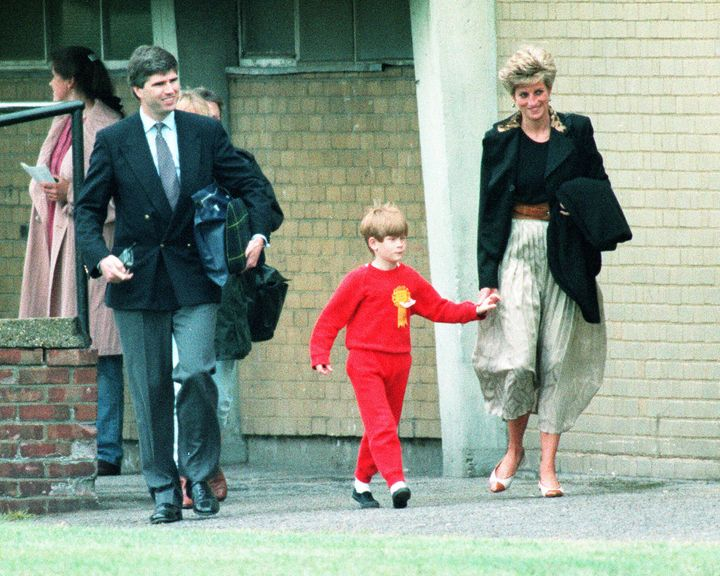 The Princess of Wales walks with Prince Harry during the Wetherby School sports day in 1991.