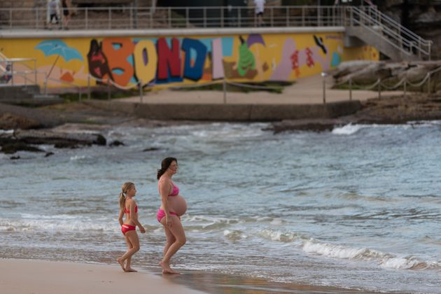 A pregnant swimmer returns to Bondi beach on April 28, 2020 in Sydney, Australia. (Photo by Brook Mitchell/Getty