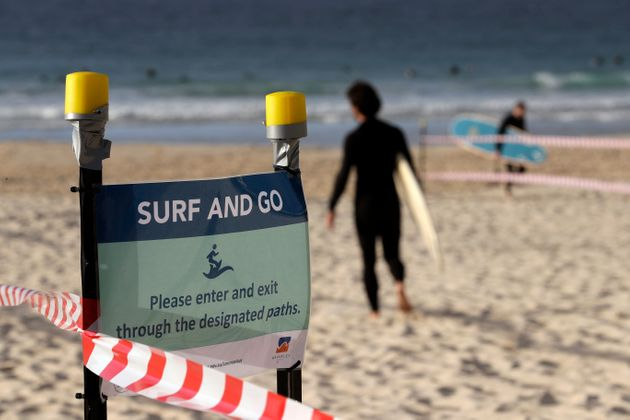 A sign tells surfers to leave once they have finished surfing at Bondi Beach in Sydney, Tuesday, April...