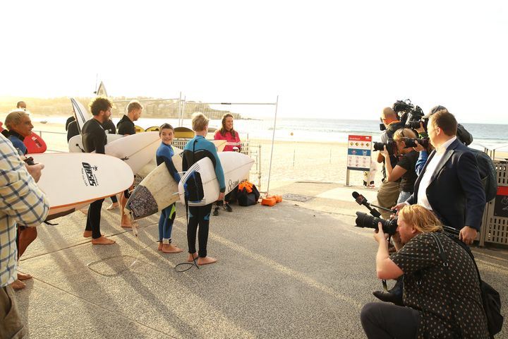 The media capture surfers waiting for the 7am reopening of Bondi beach on April 28, 2020 in Sydney, Australia. (Photo by Mark Kolbe/Getty Images)