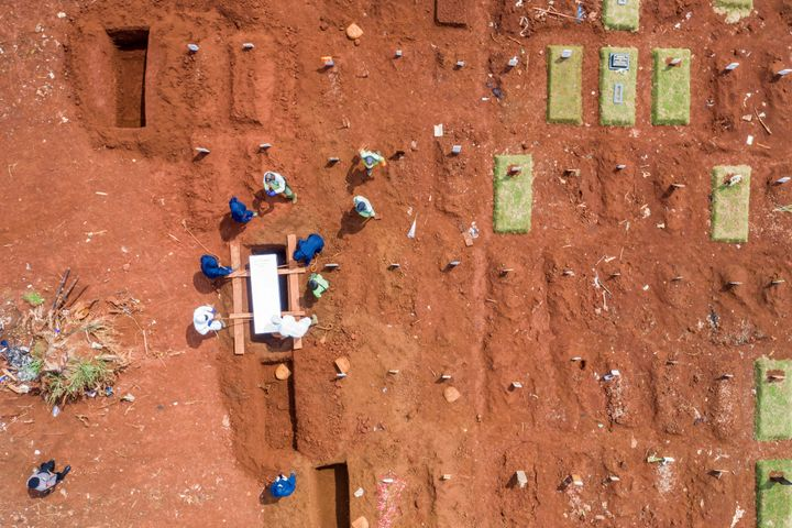 Aerial picture of municipality workers burying a coronavirus disease (COVID-19) victim at a grave complex provided by the gov