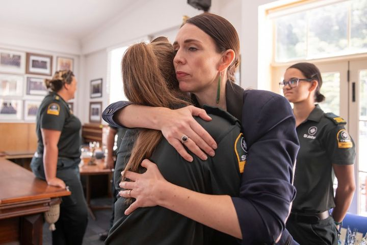 Jacinda Ardern hugs a first responder in Whakatane, New Zealand, the day after a volcanic island in New Zealand erupted on Dec. 9, 2019.