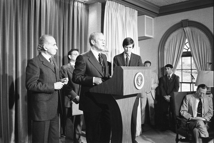 Ford announces the national swine flu immunization program in the White House press briefing room on March 24, 1976. Also sho