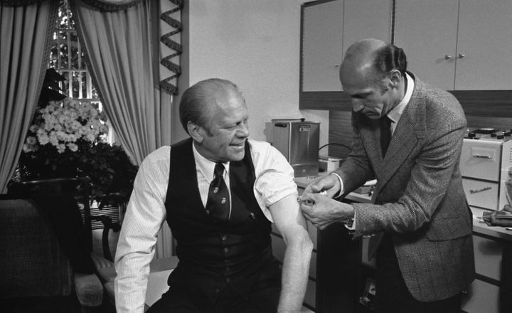 President Gerald Ford receives a swine flu vaccine from his White House physician, William Lukash, on Oct. 14, 1976.