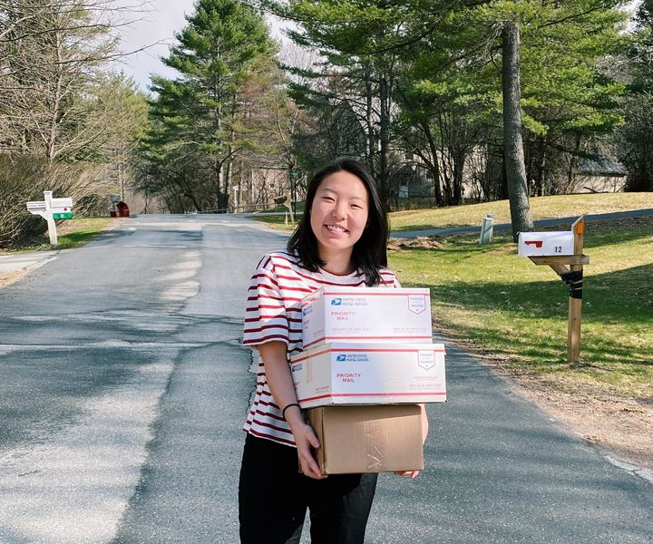 Rine (pictured) and Amy celebrate shipping their second batch of donated items to essential workers two weeks after launching
