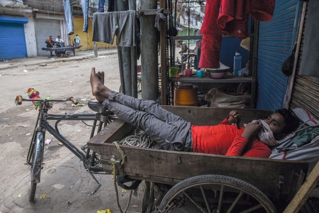 A migrant labour resting in a cycle cart in a lane in Sadar Bazar, during lockdown, on April 25, 2020...