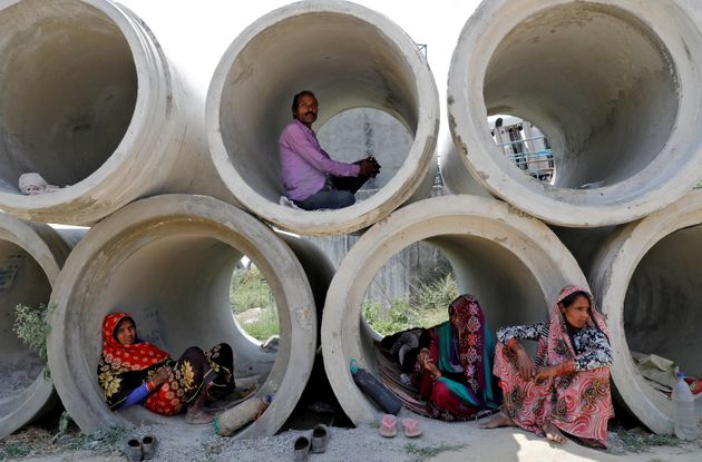 Migrant labourers rest in cement pipes during an extended nationwide lockdown to slow the spreading of...