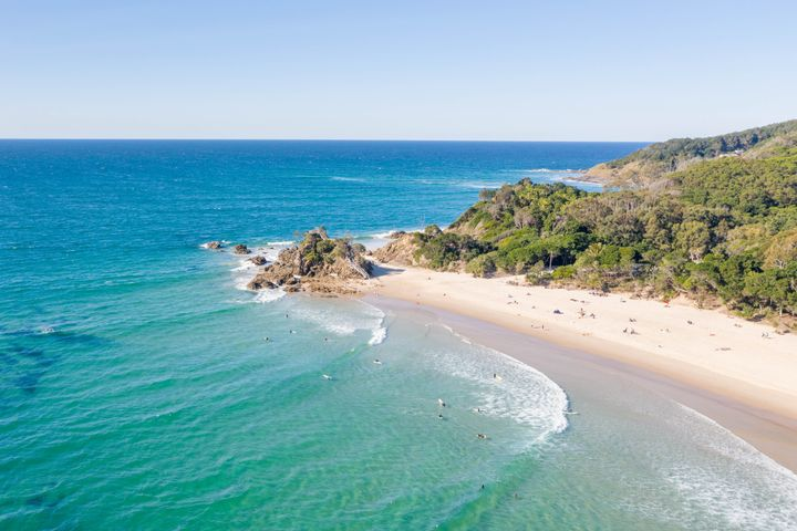A view of a busy beach at Byron Bay.