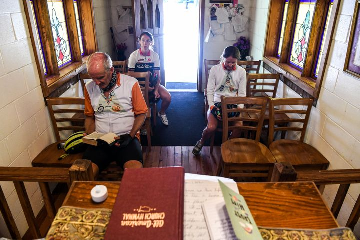 "Worshippers offer prayers inside the ""Smallest Church In America"" in Townsend, Georgia, during the novel coronavirus pandemic"