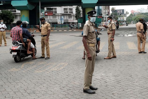 Policemen check motorcyclists in Kochi, on March 25,