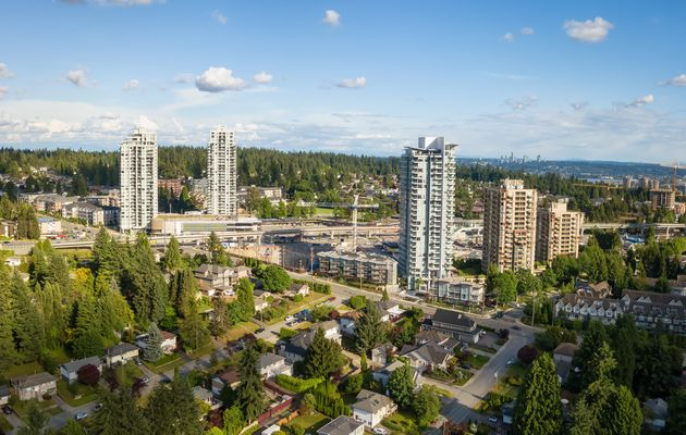 An aerial view of condo towers surrounded by low-rise homes in the Greater Vancouver city of Port Moody,...