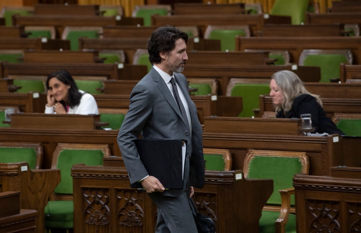Prime Minister Justin Trudeau makes his way to his seat for a COVID-19 committee meeting in the House of Commons chamber on April 29, 2020 in Ottawa.