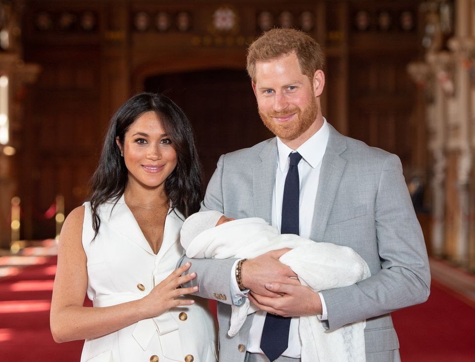 Prince Harry and Meghan Markle with their newborn son, Archie Harrison Mountbatten-Windsor, in St. George's Hall at Windsor C