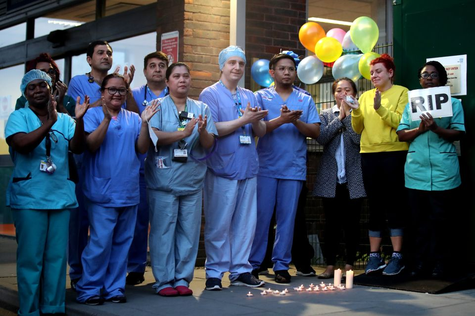 NHS workers clap outside Newham University Hospital on April