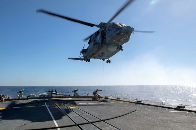 A CH-148 Cyclone helicopter is seen here hovering above the HMCS Fredericton on Feb. 15,