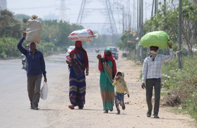 Stranded migrant workers leave for their native place in Tikamgarh, Madhya Pradesh, during lockdown,...