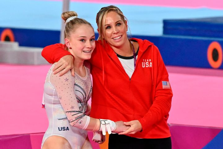 US Riley McCusker (L) is hugged by her coach Maggie Haney during the Lima 2019 Pan-American Games in Lima, on July 30, 2019.