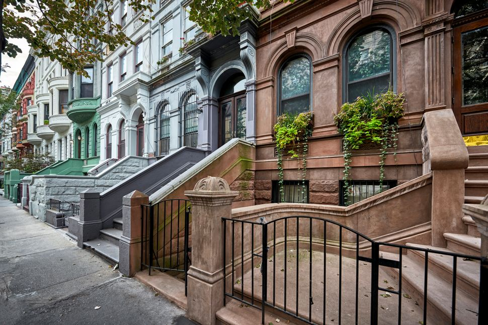 a row of colorful brownstone buidlings