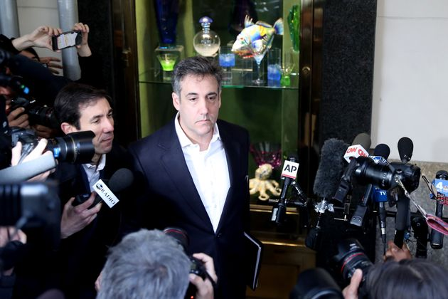 Michael Cohen leaves his apartment in May 2019 to begin serving his three-year