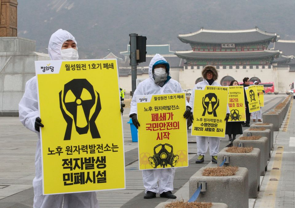 Environmentalists stage a rally against nuclear power plants near the government complex in Seoul in...