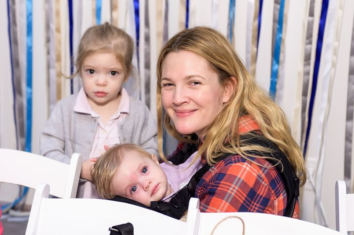 Drew Barrymore and her daughters at the Baby2Baby Holiday Party presented By The Honest Company on December 13, 2014, in Los Angeles.