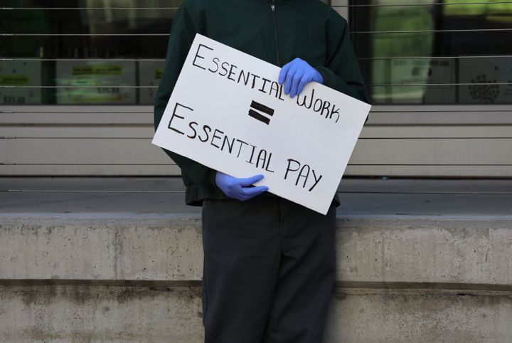 A grocery store worker at a protest in Boston on April 7.