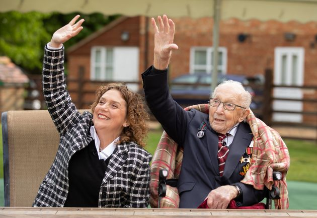 Col. Tom Moore and his daughter Hannah look up as Royal Air Force planes fly over his home on Thursday...