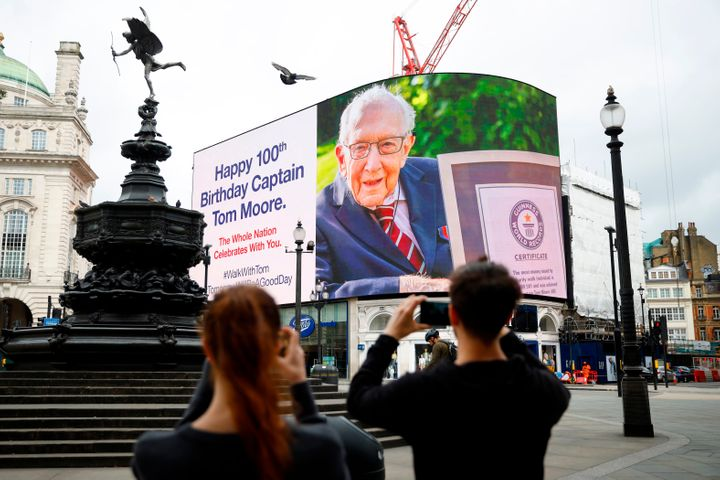 A birthday message for Tom Moore is displayed at Piccadilly Circus in London on Thursday. He turned 100 years old.