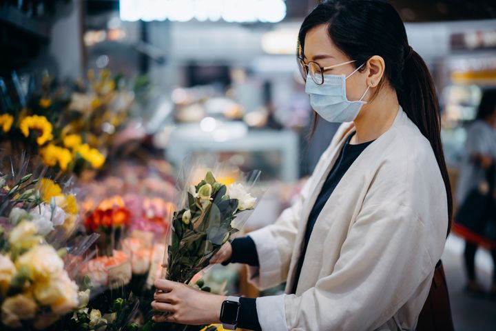 If you live in the same town as your mom, you may consider buying flowers at a grocery store or farmers market and dropping them off yourself.