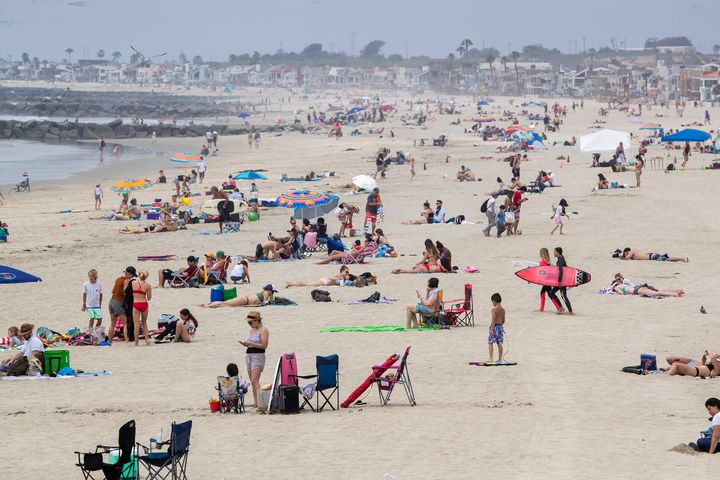 It looked much like any other day at Newport Beach in California on Tuesday despite shelter-in-place orders.