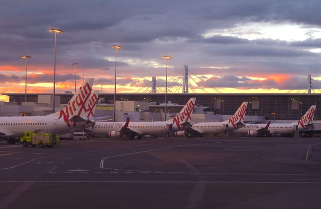 Aircraft from Australia's second largest airline, Virgin Australia, sit on the tarmac at the domestic...