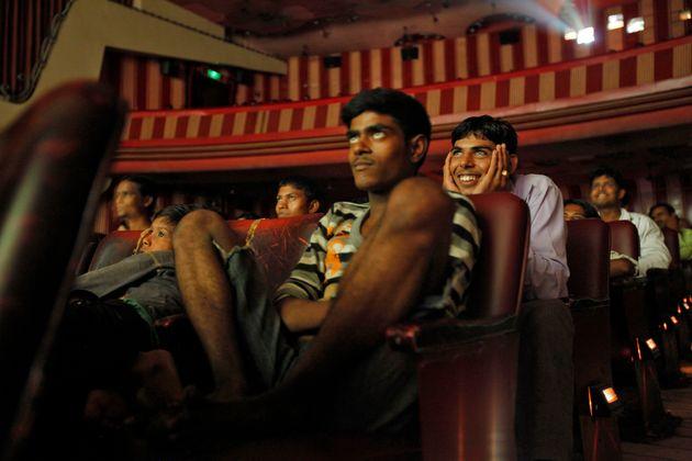 Cinema goers watch Bollywood movie