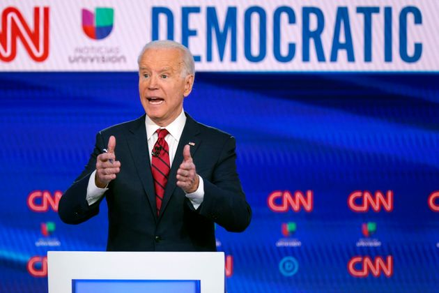 Joe Biden participates in a Democratic presidential primary debate with Bernie Sanders at CNN Studios...