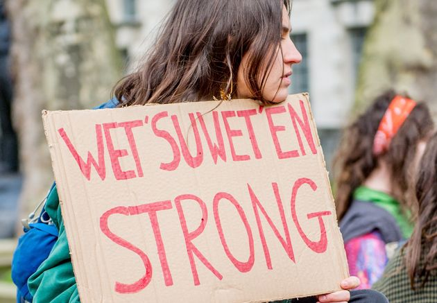 A protester holds a sign in London during a demonstration on March